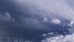 Blue sky in 4k cinematic violet slow motion. Majestic white fluffy clouds over blue light violet sky view from below - slow motion cinematic 4k UHD stock footage