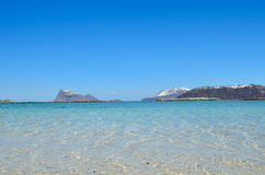 Majestic white springtime beach with snowy mountain islands Royalty Free Stock Images