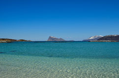 Majestic white springtime beach with snowy mountain islands Stock Photography