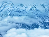 Majestic winter landscape of Dombaj mountains covered peaks with Stock Photo
