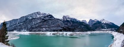 Majestic winter mountain panorama of emptied lake Stock Photography