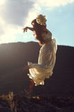 Majestic woman flying in sunset light royalty free stock photography