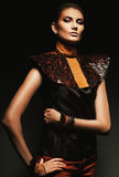 Majestic woman in leather accessories. In dark Royalty Free Stock Photos
