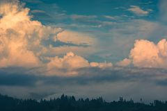 Majestic yellow clouds at sunset light Royalty Free Stock Photo