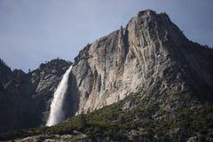 Majestic Yosemite Falls during high-flow, California, USA. Yosemite Falls plunges over granite walls of Yosemite National Park during high river flow Stock Photo