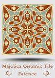 Majolica ceramic tile in beige, olive green and red terracotta. Vintage ceramic faience. Traditional spanish glaze. Pottery product with multicolored symmetric stock illustration