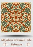 Majolica ceramic tile in beige, olive green and red terracotta. Vintage potttery faience. Traditional pottery product. spanish cer. Ceramic tile in beige, olive Royalty Free Stock Photography