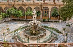 The majolica cloister with fountain in courtyard of the Santa Caterina church, Palermo, Sicily Stock Photography