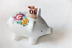 Majolica piggy bank with ten Euro banknote Stock Photo