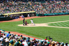 Major League Baseball - Beautiful Day for a Game. Its a beautiful day for baseball in Oakland as Seth Smith of the Oakland As gets ready to hit as the colorful Royalty Free Stock Photography