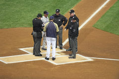 Major League Baseball Umpire and Managers. Major League Baseball, Colorado Rockies versus Milwaukee Brewers at Milwaukee, WI in a stadium with a covered roof stock photography