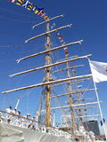 Major mast, flags and crew Stock Photo