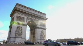 Major tourist attraction in Paris, Triumphal Arch against blue sky background. Stock footage stock footage