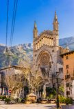 Majorca, beautiful view of Soller with church and mountains. View of Sant Bartomeu picturesque cathedral in Soller town, Mallorca island, Spain stock image