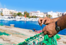 Majorca Cala Ratjada fisherman sewing fishing net Stock Photos