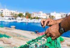 Majorca Cala Ratjada fisherman sewing fishing net Stock Photos