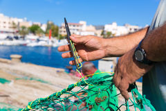 Majorca Cala Ratjada fisherman sewing fishing net Royalty Free Stock Image