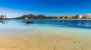 Majorca island, beach scenery at coast of bay of Alcudia, Spain Balearic Islands. Idyllic island scenery, seaside of Alcudia bay on Mallorca, Spain Mediterranean royalty free stock photo