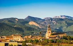 Majorca panorama view of mediterranean village with mountain range of Serra de Tramuntana. Royalty Free Stock Photos