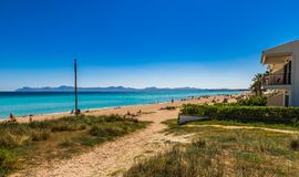 Spain Mallorca island, coastline of beach at bay of Alcudia. Majorca sand beach in Can Picafort, Platja de Muro at bay of Alcudia, Spain Balearic islands Royalty Free Stock Photos