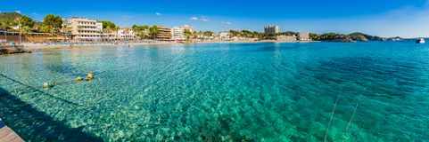 Majorca Spain, beach seaside of coast in Paguera, panorama view. Mallorca beach panorama of Platja Palmira, beautiful coastline in Peguera, Spain Mediterranean royalty free stock photo