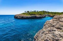 Majorca Spain Coast Bay with boat. Spain, Mediterranean Sea, Mallorca island scenery, idyllic bay with sailing boat Royalty Free Stock Photography
