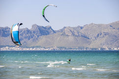MAJORCA, SPAIN - JULY 9 2013: Surfers enjoying tourist free sunn stock photography