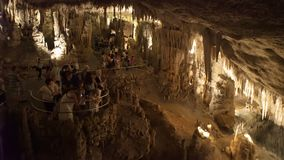 A Lot of tourists descend into the famous stalactite caves of Drach Cuevas del Drach stock video footage