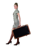 Majorette with suitcase Stock Images