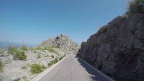 Majorque, Espagne Laps de temps de la route panoramique et de touristes menant au port de SA Calobra La route célèbre de noeud de