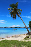 Majuro Beach. A fisherman sails across a beach in Majuro, Marshall Islands, South Pacific Stock Photo