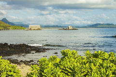 Makai Research Pier. View of Makai Research Pier in Waimanalo Bay with Koolau mountain range in the distance on Oahu, Hawaii Stock Photography