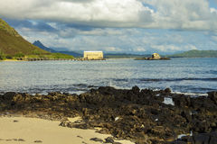Makai Research Pier. View of Makai Research Pier in Waimanalo Bay with Koolau mountain range in the distance on Oahu, Hawaii Royalty Free Stock Photo