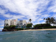 Makalei Beach with waves lapping, napakaa, lava rock wall and Co Stock Image
