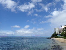 Makalei Beach with waves lapping, napakaa, lava rock wall and sm Royalty Free Stock Image
