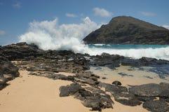 Makapuu beach Hawaii. Waves crashing on rocks on Makapuu beach Oahu island, Hawaii Stock Images