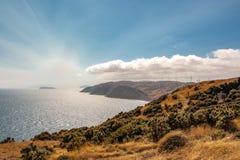 Makara Coast Wind Turbines. View over south coast of Wellington towards Mana Island and wind farm royalty free stock photography
