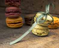Makarons wiht  green silk ribbon on old table Royalty Free Stock Photography