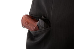 Makarov pistol in the pocket of a person Stock Images