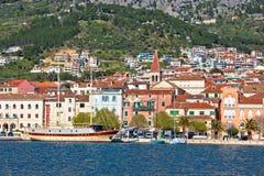 Makarska boats and waterfront under Biokovo mountain view Stock Photo