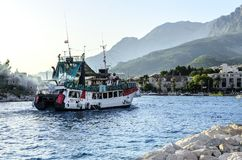 Excursion ship in the port of Makarska, Croatia. MAKARSKA, CROATIA 10 JULY, 2017: Excursion ship in the port of Makarska at sunset, Croatia Royalty Free Stock Photos