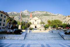 Makarska, Croatia, September 12, 2015. Exteriors of the Roman Catholic main church of Makarska, in the evening sun. Royalty Free Stock Photo