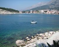 Makarska Dalmatia Croatia. Harbour of Makarska, Croatia, with a fisherman rowing Royalty Free Stock Photo