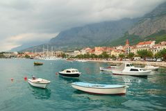 Makarska town harbor with small boats Royalty Free Stock Image