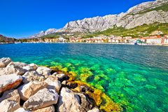 Makarska turquoise waterfront and Biokovo mountain view Royalty Free Stock Images