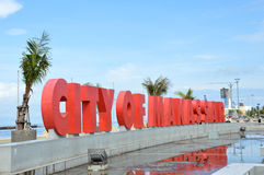 Makassar landmark. Large letters  Citi of Makassar on the beach Losari, Makassar Indonesia Royalty Free Stock Photo