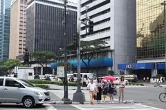 Makati City, Manila. MANILA, PHILIPPINES - DECEMBER 7, 2017: People visit Makati City, Metro Manila, Philippines. Metro Manila is one of the biggest urban areas Royalty Free Stock Image