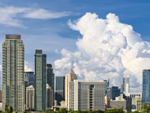 Makati Skyline. Shot against blue sky and white clouds stock photos