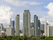 Makati Skyline. Shot against blue sky and clouds royalty free stock image