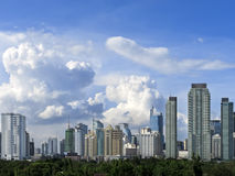 Makati Skyline. Shot against blue sky and swirling clouds royalty free stock photo